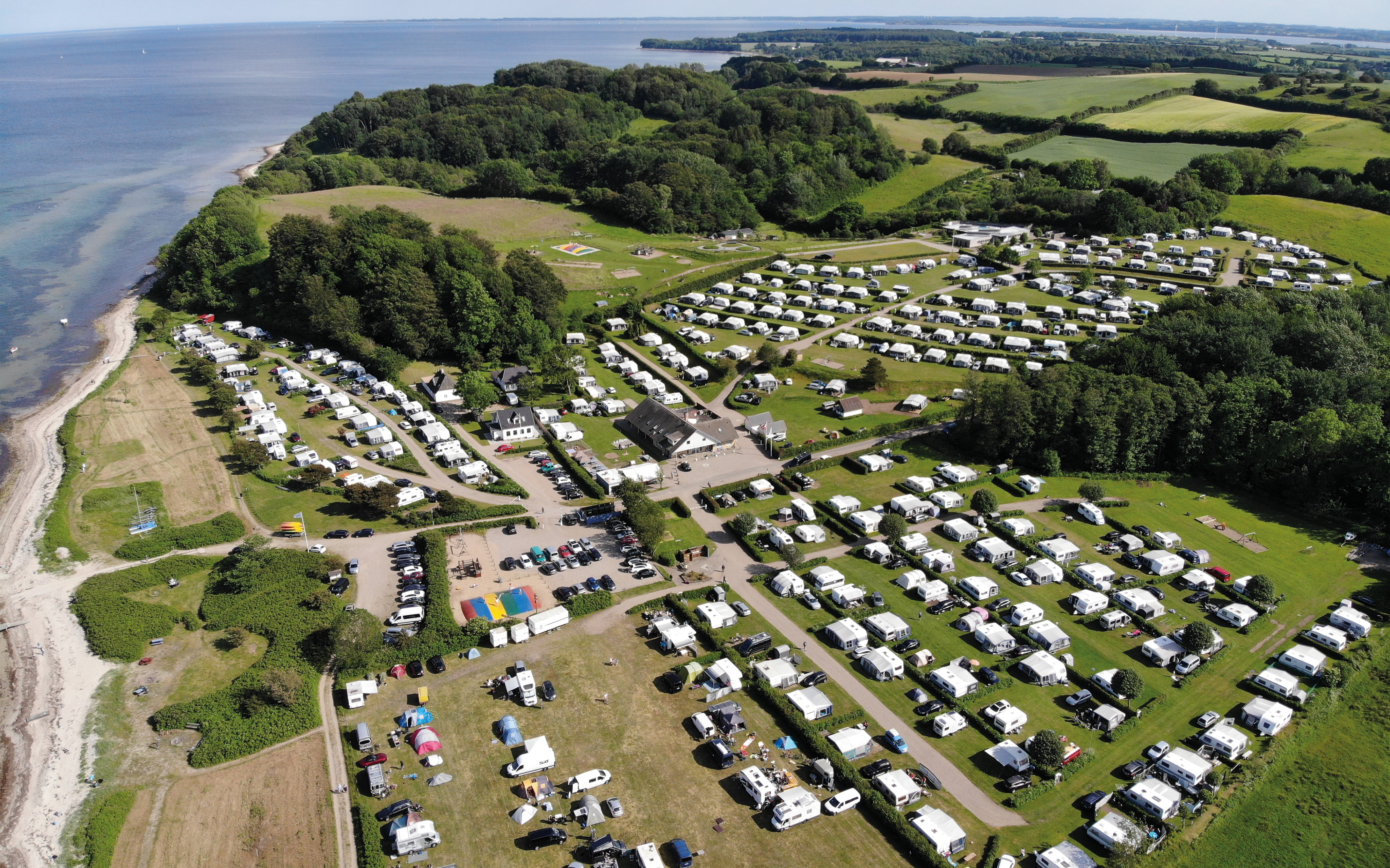 Aerial photo and overview over the 6 different camping areas at Gammelmark Strand Camping